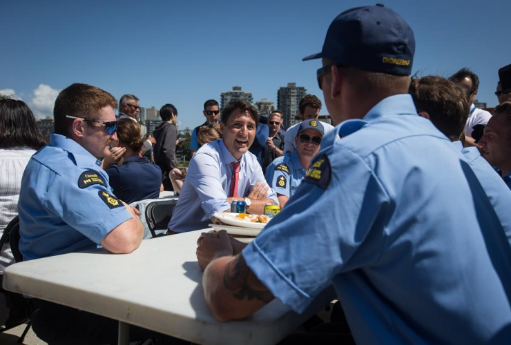 Prime Minister Justin Trudeau, members of the Canadian Coast Guard,