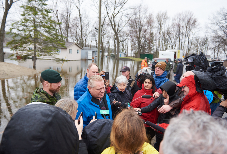 Ontario Premier Doug Ford speaks with media in a partially flooded area of Constance Bay northwest of Ottawa on April 26, 2019. Photo by Kamara Morozuk