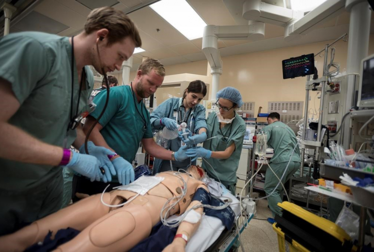 Dr. Christopher Tsoutsoulas, Dr. Craig Brick, Diana Kanlic, Dr. Clare Toguri, medical mannequin, trauma bay, St. Michael's Hospital, Toronto,