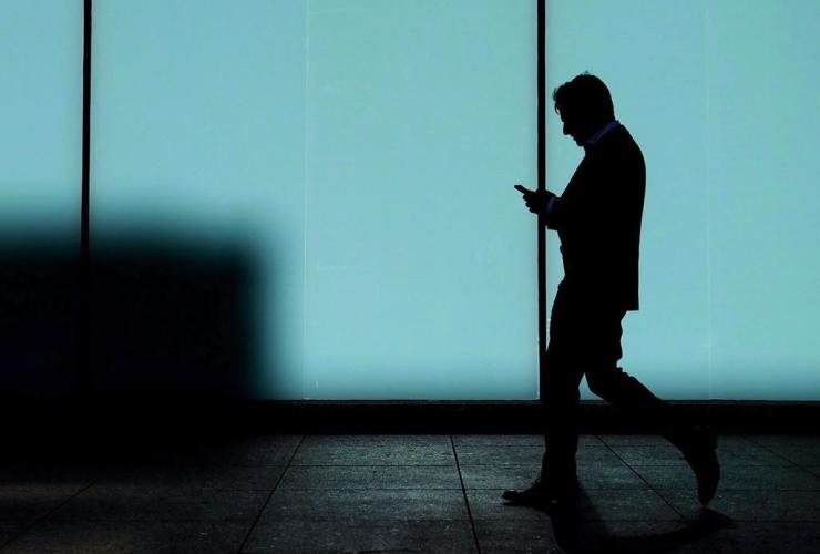 man, walks, texts, smart phone, Toronto,