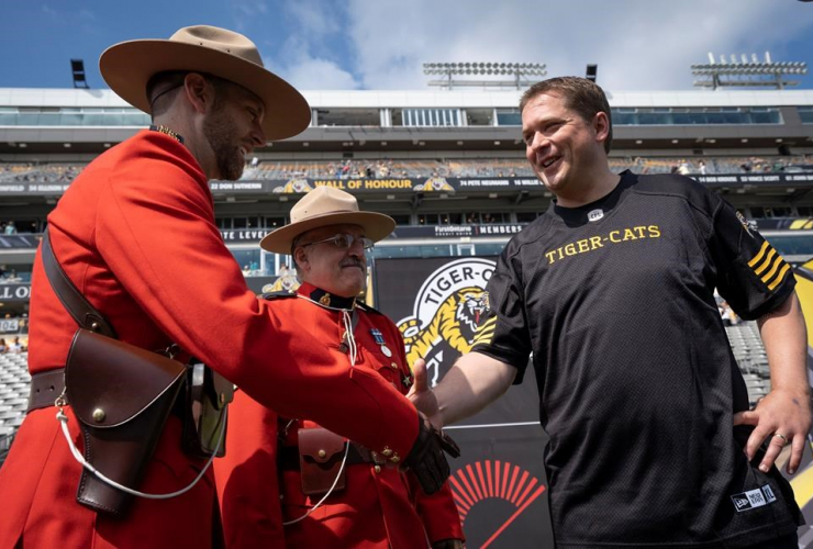 Conservative Leader Andrew Scheer, Royal Canadian Mounted Police officers, CFL football, Hamilton,
