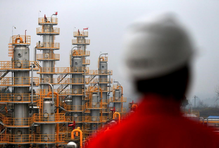 In this Jan. 22, 2016 photo, a worker stands at a natural gas plant owned by China's state-owned enterprise PetroChina in Suining in southwestern China's Sichuan province. File photo by The Associated Press/Chinatopix