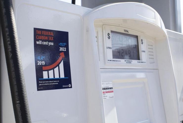 gas pump, anti-carbon tax sticker, Toronto,
