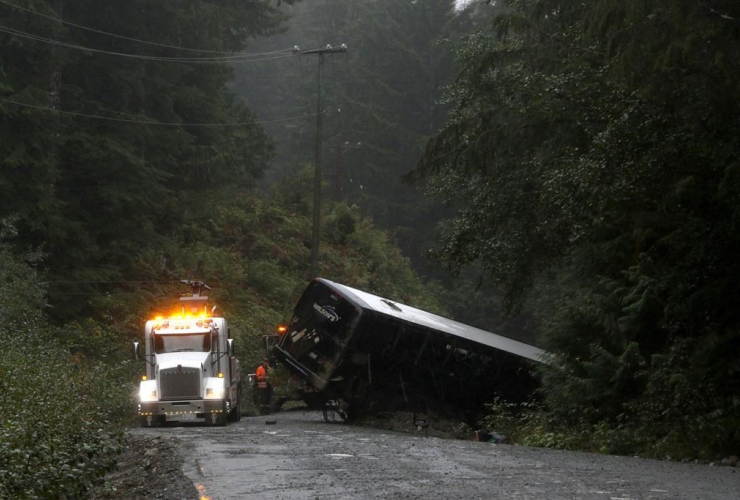 tow-truck crew, bus, logging road, Bamfield,