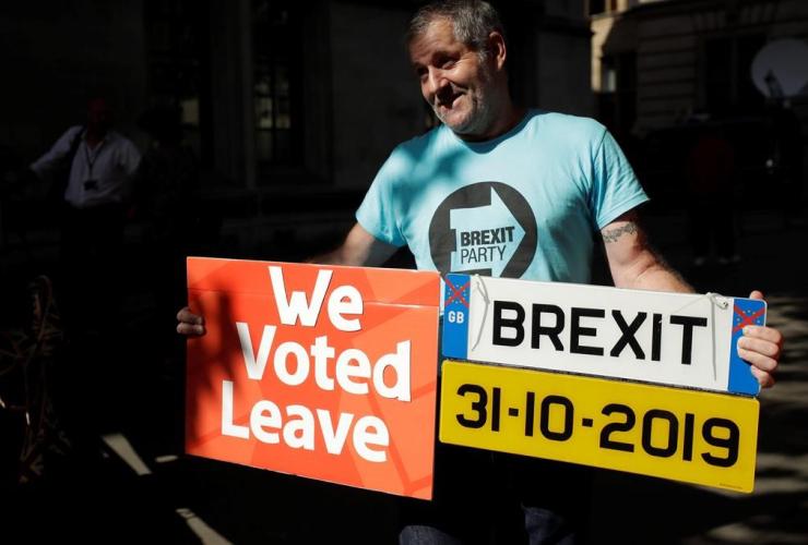 Brexit supporter, placard, mock car number plate, Supreme Court, London,