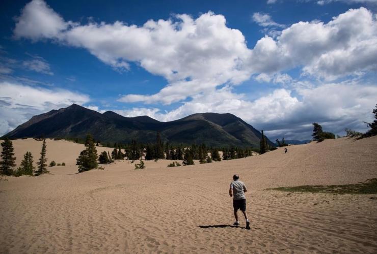 man, runs, Carcross Dunes, Carcross, Yukon,