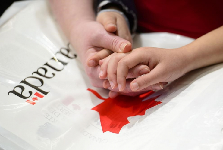 mother, hands, daughter, new Canadians, Oath of Citizenship,