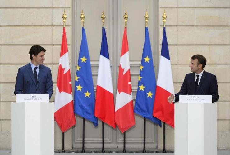 Prime Minister Justin Trudeau, French President Emmanuel Macron,