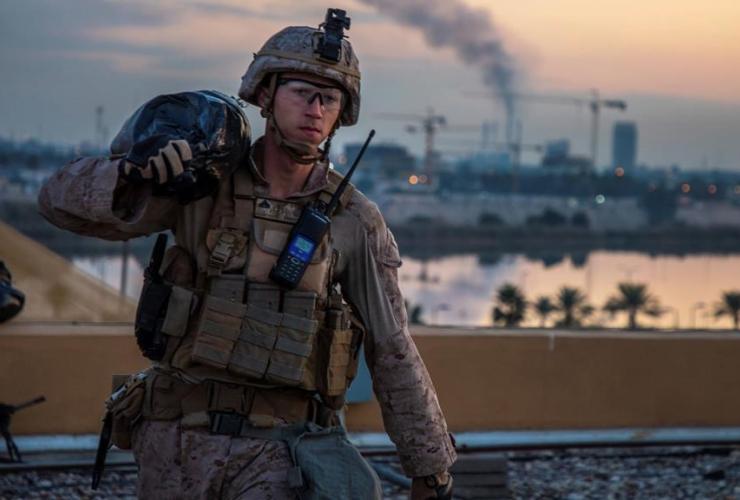U.S. Marine, carries, sand bag, U.S. embassy compound, Baghdad, Iraq,