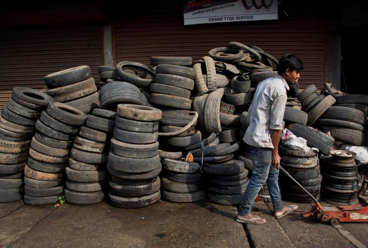 Indian youth, trolly, tires, recycling, Gauhati, India,