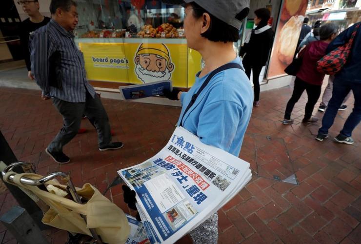 vendor, newspaper, Wuhan, coronavirus, Hong Kong, SARS,