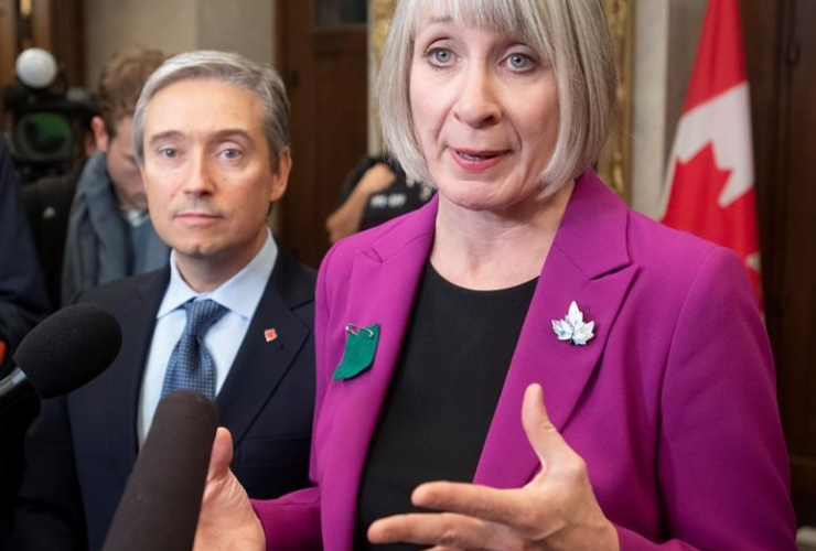 Foreign Affairs Minister Francois-Philippe Champagne, Minister of Health Patty Hajdu,