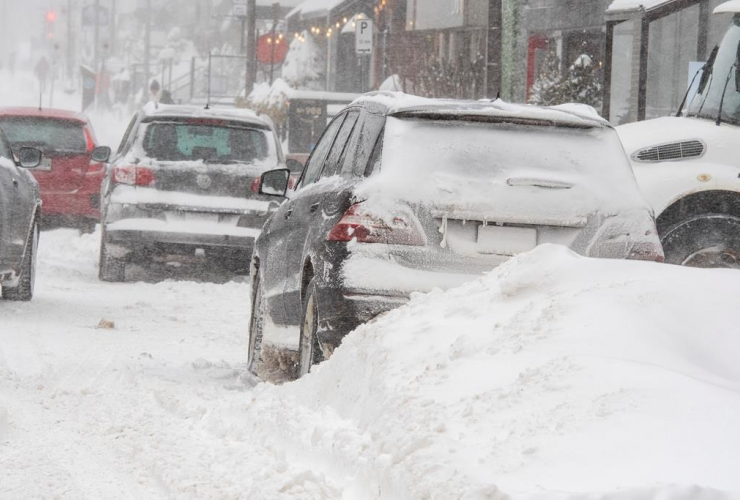 Vehicles, snow-covered streets, snowstorm,