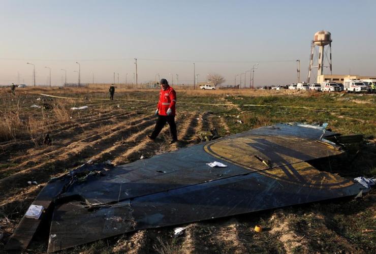 rescue worker, Ukrainian plane, crashed, Shahedshahr, Tehran, Iran,