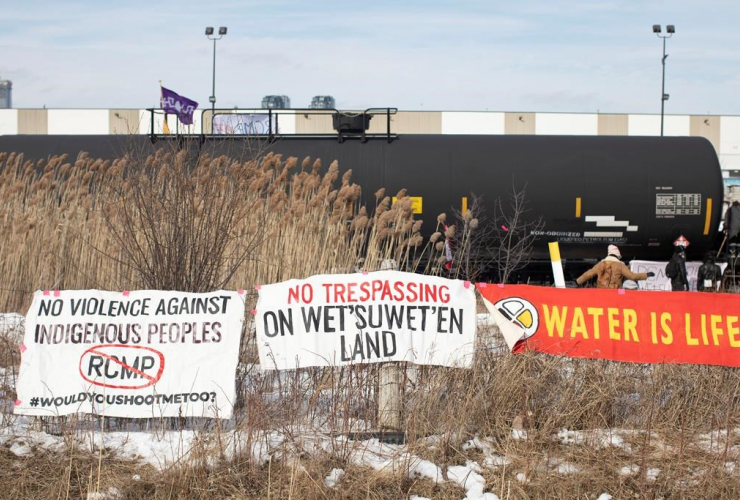 Banners, protesters, blockade, rail line, Macmillan Yard, Toronto,