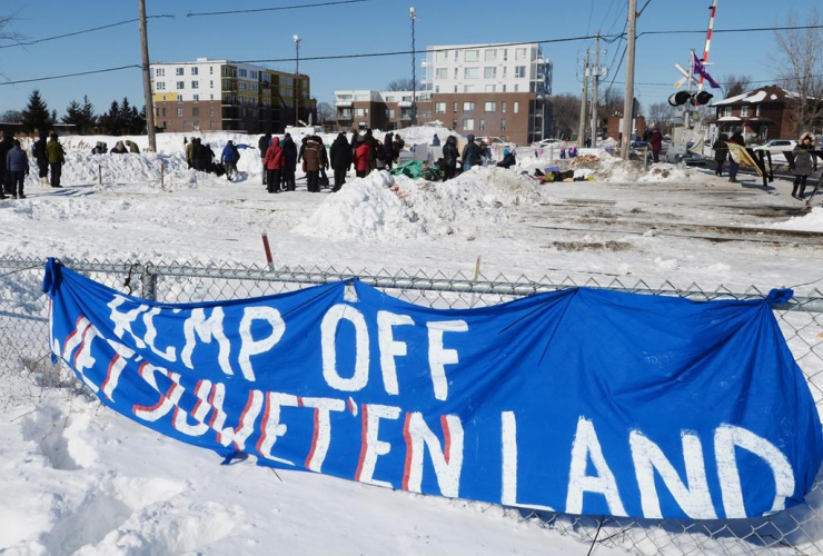 People protest at a rail blockade in St-Lambert, south of Montreal, Que. on February 20, 2020 in solidarity with the Wet'suwet'en hereditary chiefs opposed to the LNG pipeline in northern British Columbia. Photo by The Canadian Press/Ryan Remiorz