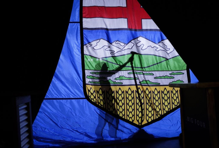 campaign worker, Alberta flag, United Conservative Party, Jason Kenney,