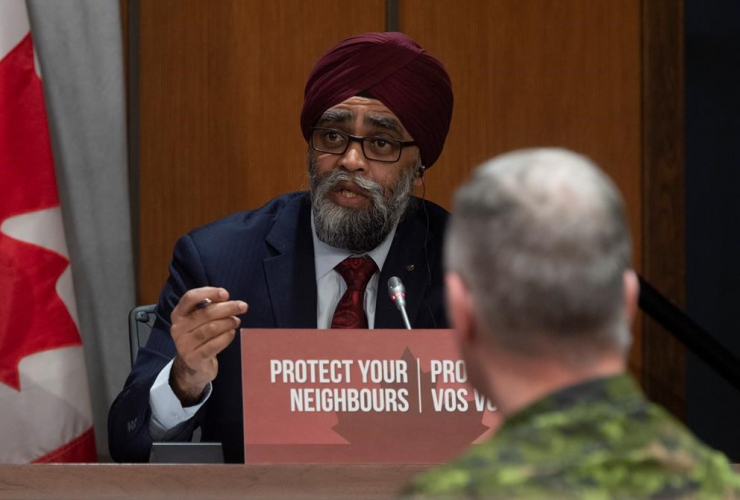 Chief of Defence Staff Jonathan Vance, National Defence Minister Harjit Sajjan,