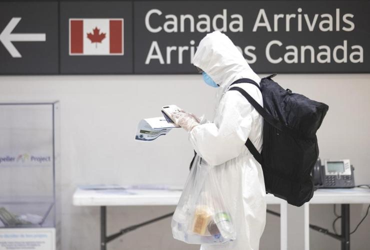 traveller, International arrivals hall, Toronto, Pearson Airport,