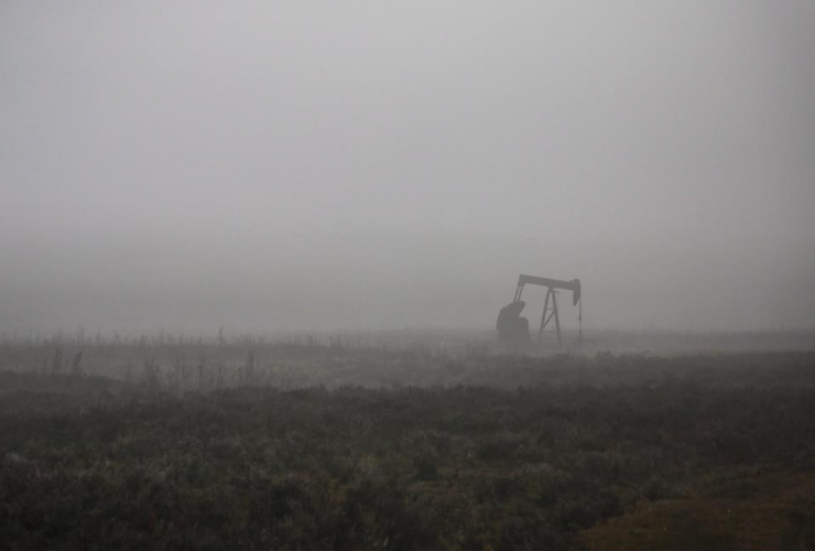 pumpjack, oil and gas installation, foggy day, Cremona, Alta.,