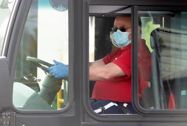 Toronto Transit Commission bus driver, mask, gloves, bus, Toronto,