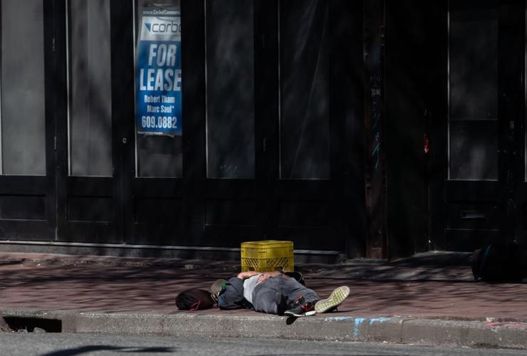 man, sleeps, sidewalk, Downtown, Eastside of Vancouver,