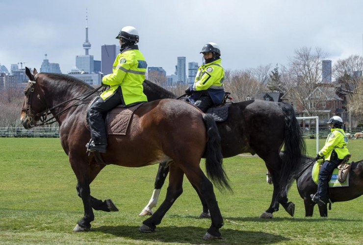 Toronto Police Mounted Unit officers, patrol, city park, Toronto,