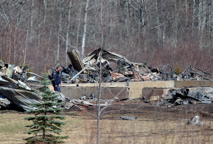 RCMP investigator, inspects, house, destroyed,  fire, Alanna Jenkins, Sean McLeod,