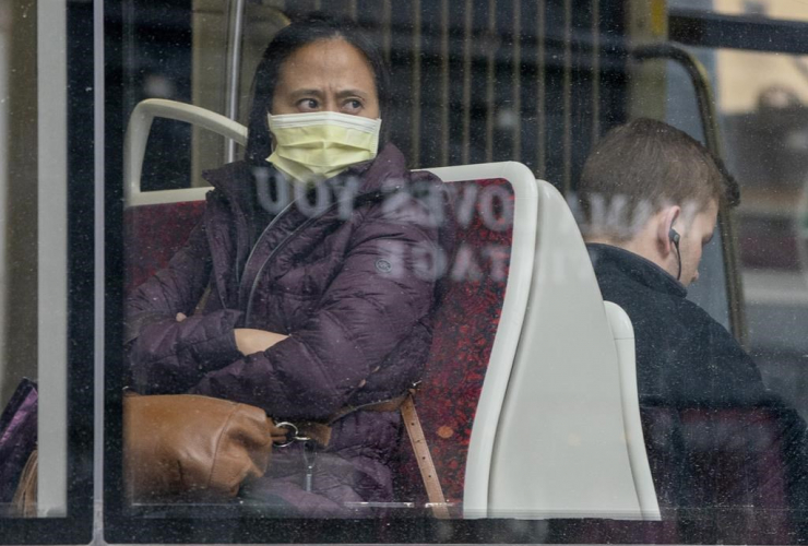 woman, wears, mask, TTC streetcar,