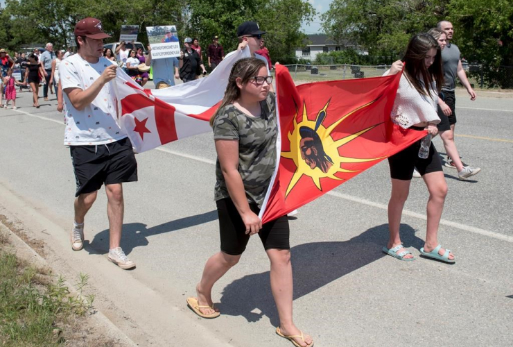 People walk to honour Rodney Levi in Red Bank, New Brunswick on Friday, June 19, 2020. File photo by The Canadian Press/Stephen MacGillivray