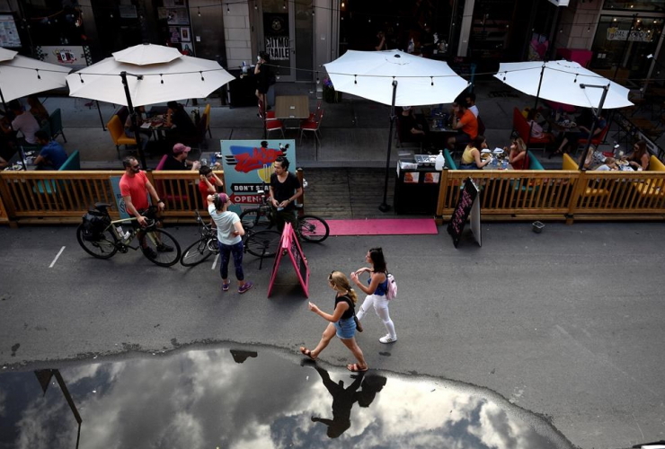 People, outdoor booths, street parking spots, restaurant, COVID-19 pandemic,
