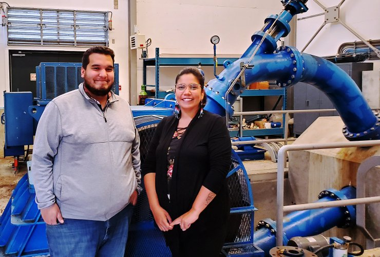 Kitasoo First Nation councillor and public works manager Isaiah Robinson and Chief Coun. Roxanne Robinson stand by a hydroelectric turbine in their territories in July 2020