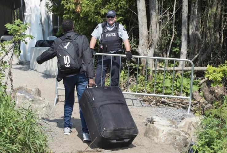 asylum seeker, RCMP officer, border, Canada, United States,