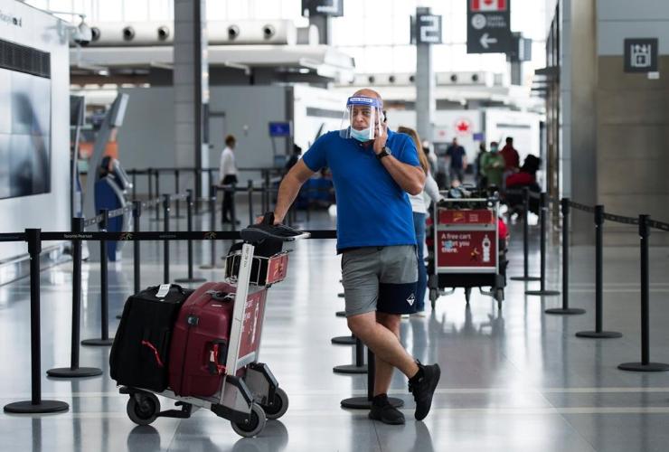 man, mask, full face shield, Pearson International Airport,