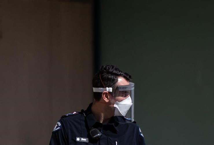 B.C. Ambulance Service paramedic, face shield, N95 mask,