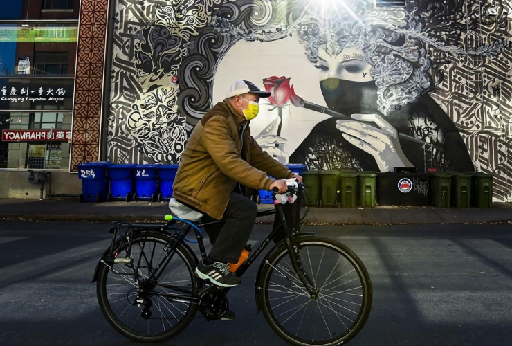 man, protective mask, bicycle,