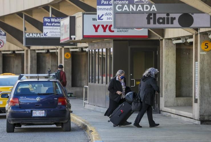 Passengers, masks, Calgary Airport,