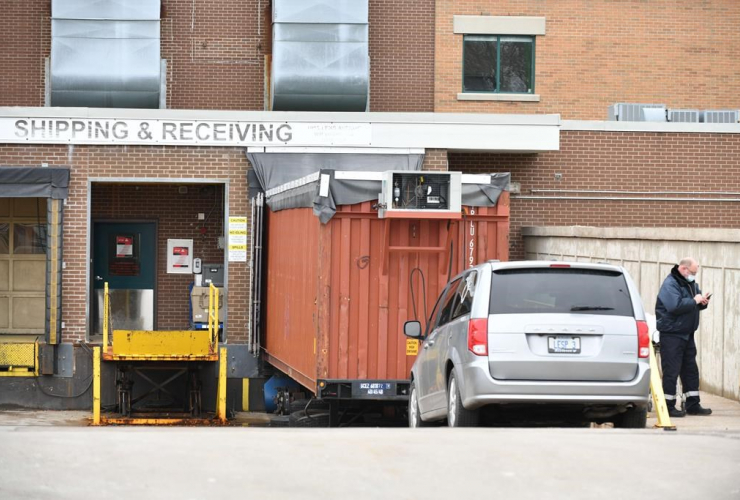 minivan, funeral home, storage container, temporary morgue, Windsor Regional Hospital Met Campus,