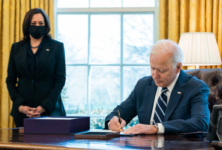"President Joe Biden, joined by Vice President Kamala Harris, signs H.R. 1319, the ""American Rescue Plan Act of 2021"" Thursday, March 11, 2021, in the Oval Office of the White House."