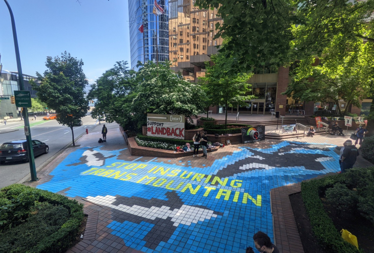 """Mural that says """"Stop Insuring Trans Mountain"""""""