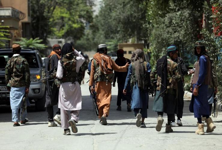 Taliban fighters,
