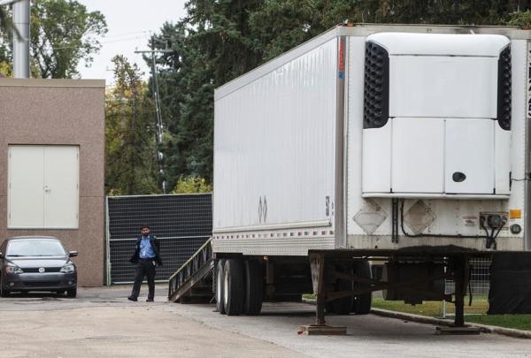 security guard, bodies, rented trailer, medical examiner, space shortage, Edmonton,
