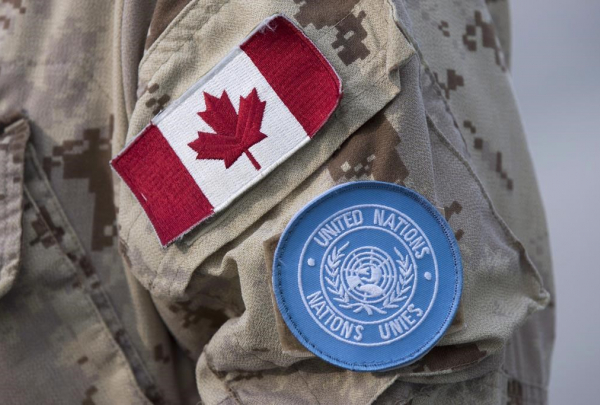 Canadian and UN flags, Canadian soldier's uniform,