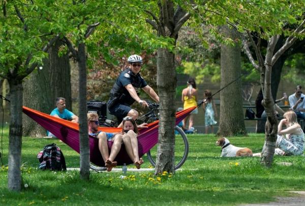 bicycle police officer, patrols, Trinity Bellwoods Park, Toronto,